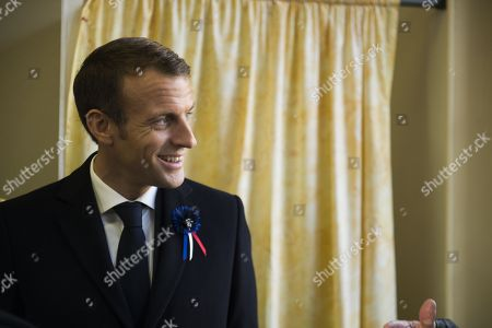 French President Emmanuel Macron attends a meeting to commemorate French author Maurice Genevoix (1890-1980) at the town hall