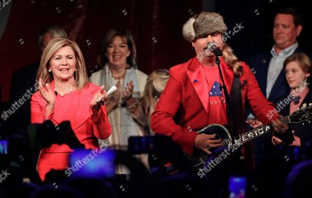 Marsha Blackburn, John Rich. Rep. Marsha Blackburn, R-Tenn., claps along as John Rich performs after Blackburn was declared the winner over former Gov. Phil Bredesen in their race for the U.S. Senate, in Franklin, Tenn