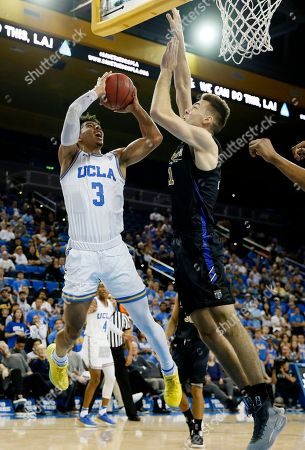 Jules Bernard, Dylan Carl. UCLA guard Jules Bernard shoots as Fort Wayne forward Dylan Carl defends during the second half of an NCAA college basketball game, in Los Angeles