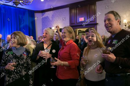 Attendees cheer while at Democrat candidate Chris Pappas election watch party in the race with Republican Eddie Edwards at the The Puritan Backroom Conference Center in Manchester, New Hampshire, USA, 06 November 2018. Chris Pappas and Eddie Edwards are running for the seat for the United States Representative in the 1st District of New Hampshire.