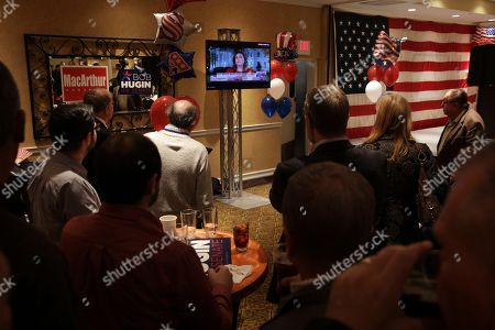 Supporters watch television at an election watch party for Tom MacArthur, the Republican candidate in New Jersey's third Congressional District, in Toms River, N.J. MacArthur, the Republican incumbent is facing Democrat Andy Kim in New Jersey's third Congressional District