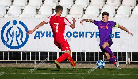 Adam Lewis of Liverpool takes on Njegos Kupusovic of Red Star Belgrade