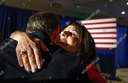Wisconsin Republican Senate candidate Leah Vukmir hugs a supporter after speaking at an election night event, in Pewaukee, Wis. Vukmir was defeated by Democratic incumbent Sen. Tammy Baldwin