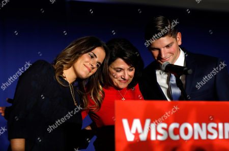 Wisconsin Republican Senate candidate Leah Vukmir huddles with her children Elena and Nicholas at an election night event, in Pewaukee, Wis. Vukmir was defeated by Democratic incumbent Sen. Tammy Baldwin