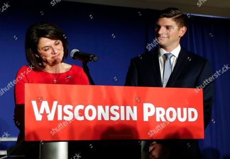 Wisconsin Republican enate candidate Leah Vukmir speaks with her son Nicholas at an election night event, in Pewaukee, Wis. Vukmir was defeated by Democratic incumbent Sen. Tammy Baldwin