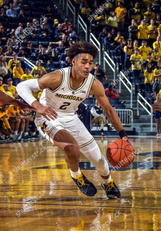 bd9d689336c Michigan guard Jordan Poole (2) dribbles the ball in the second half of an