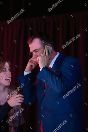 Oklahoma Republican Governor-elect, Kevin Stitt, takes a phone call immediately following his speech to supporters during a watch party in Oklahoma City, . Stitt defeated former Democratic attorney general Drew Edmondson in Tuesday's election to replace term-limited Republican Gov. Mary Fallin