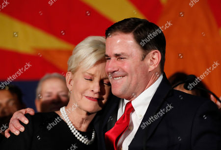 Doug Ducey, Cindy McCain. Republican Arizona Gov. Doug Ducey, R, embraces Cindy McCain, wife of the late U.S. Sen. John McCain, while speaking to supporters, at an election night party in Scottsdale, Ariz. Incumbent Ducey defeated Democratic challenger David Garcia for his second term