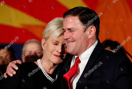 Doug Ducey, Cindy McCain. Republican Arizona Gov. Doug Ducey embraces Cindy McCain, wife of the late U.S. Sen. John McCain, while speaking to supporters, at an election night party in Scottsdale, Ariz. Incumbent Ducey defeated democratic challenger David Garcia for his second term