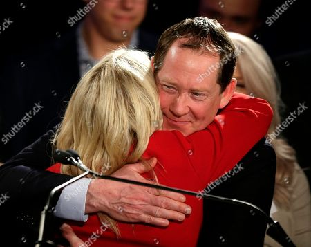 Stock Photo of Buffalo Sabres head coach Phil Housley hugs his wife Karin Housley after she made her concession speech at the Republican election night party, in a special election to fill the vacated seat of former Sen. Al Franken, in Bloomington, Minn