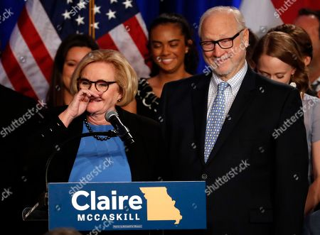 Sen. Claire McCaskill, D-Mo., delivers a concession speech while surrounded by family including her husband, Joseph Shepard, right, in St. Louis. McCaskill has conceded defeat to Republican challenger Josh Hawley in her bid for a third term