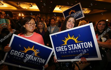 Supporters of U.S. Rep-elect Greg Stanton, D-Ariz., celebrate his win at an election night gathering for Democrats, in Phoenix. Stanton defeated Republican Steve Ferrara in Arizona's 9th Congressional District