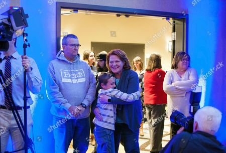 Sen. Heidi Heitkamp, D-N.D., gets a hug from Lyric Mauk, 8, of Fargo, N.D.,. before she speaks to supporters at an election night watch party, in West Fargo, N.D. Republican Rep. Kevin Cramer defeated Heitkamp