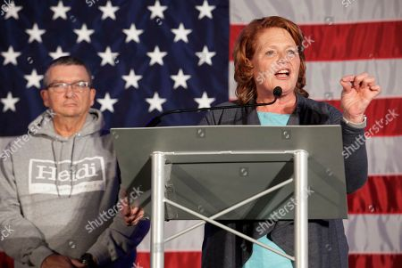 Sen. Heidi Heitkamp, D-N.D., addresses supporters at an election night watch party, in West Fargo, N.D. Republican Rep. Kevin Cramer defeated Heitkamp. Heitkamp's husband, Darwin Lange, is at left