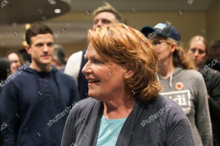 Well-wishers surround Sen. Heidi Heitkamp, D-N.D., after she addressed supporters at an election night watch party, in West Fargo, N.D. Republican Rep. Kevin Cramer defeated Heitkamp