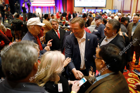 Sen. Dean Heller, R-Nev., greets supporters during the NVGOP Election Night Watch Party in Las Vegas