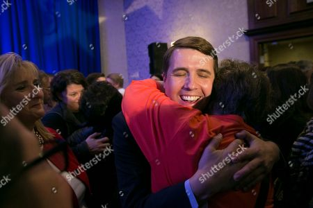 Democrat Chris Pappas (C) hugs a supporter after declaring victory over his opponent Republican Eddie Edwards, at his election night headquarters at the The Puritan Backroom, Conference Center in Manchester, New Hampshire, USA, 06 November 2018. Democrat Chris Pappas defeated Republican Eddie Edwards in the seat for the United States Representative in the 1st District of New Hampshire.