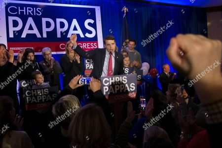 Stock Image of Democrat Chris Pappas (C) declares victory over his opponent Republican Eddie Edwards,  at his election night headquarters at the The Puritan Backroom, Conference Center in Manchester, New Hampshire, USA, 06 November 2018. Democrat Chris Pappas defeated Republican Eddie Edwards in the seat for the United States Representative in the 1st District of New Hampshire.