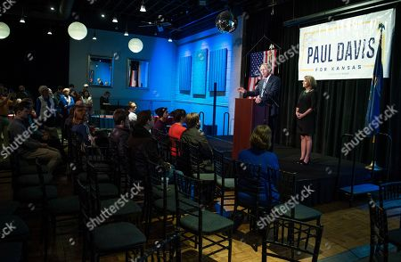 Paul Davis, the Democratic candidate in Kansas' 2nd Congressional District, delivers his concession speech as his wife, Stephanie Davis, stands next to him during an election watch party, in Lawrence, Kan. Davis announced he was done running for public office
