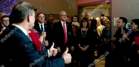 Republican Senate candidate Kevin Cramer, middle, gets the thumbs up while he waits to address his supporters at his election night victory rally, in Bismarck, N.D. Cramer defeated Sen. Heidi Heitkamp, D-N.D