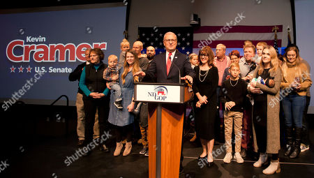 Republican Senate candidate Rep. Kevin Cramer, flanked by his wife Chris, right and other members of his family, talks to supporters at his election night victory rally, in Bismarck, N.D. Cramer defeated Sen. Heidi Heitkamp, D-N.D