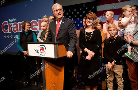Republican Senate candidate Kevin Cramer, flanked by his wife Chris, and his family, talks to supporters at his election night victory rally, in Bismarck, N.D. Cramer defeated Sen. Heidi Heitkamp, D-N.D