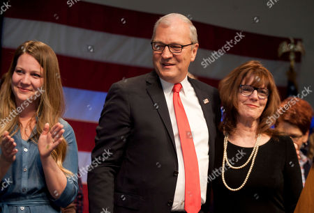 Republican Senate candidate Kevin Cramer, flanked by his wife Chris, right and other members of his family, talks to supporters at his election night victory rally, in Bismarck, N.D. Cramer defeated Sen. Heidi Heitkamp, D-N.D