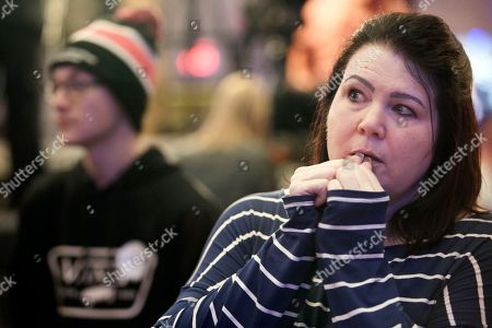 "Meg Litts of Fargo, N.D., watches results on a television during an election night watch party, in West Fargo, N.D. Litts voted for Sen. Heidi Heitkamp, D-N.D., and said Heitkamp's loss to Republican Rep. Kevin Cramer was ""a hard one"