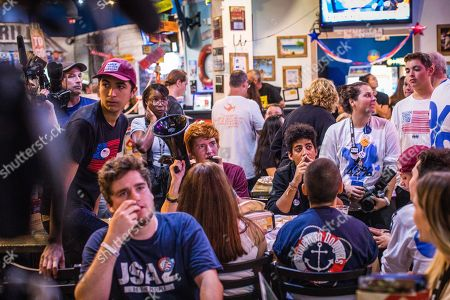 March For Our Lives members Ryan Deitsch, Emma Gonzalez, Jaclyn Corin, David Hogg, and others watch as results are announced during midterm elections watch party hosted by Change the Ref and March For Our Lives at Hurricane Wings in Coral Springs, Florida