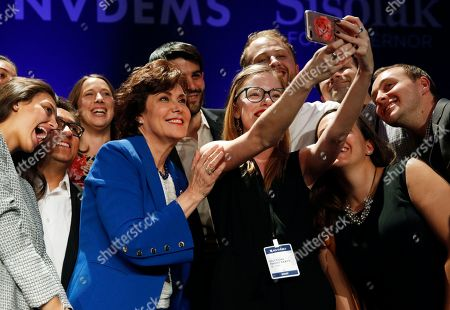 Stock Photo of Rep. Jacky Rosen, D-Nev., in blue, poses for a selfie at a Democratic election night party after defeating Sen. Dean Heller, R-Nev., in Las Vegas
