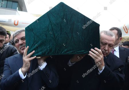 Stock Photo of Turkey's President Recep Tayyip Erdogan, right, and former president, Abdullah Gul, left, carry the coffin of businessman Abdullah Tivnikli, during his funeral procession in Istanbul