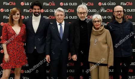 Spanish producer and President of the Atletico Madrid soccer club Enrique Cerezo (C) poses with Spanish actors Natallia Molina (L), Miguel Angel Munoz (2-L), Jose Sacristan (3-R), Concha Velasco (2-R) and Santiago Segura (R) during the presentation of the 'FlixOle' platform, dedicated to Spanish cinema and held on the Royal Spanish Academy (RAE) headquarters in Madrid, Spain, 07 November 2018.