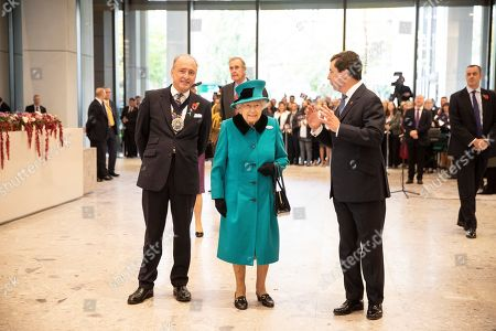 Queen Elizabeth II is greeted by Charles Bowman, the Lord Mayor of the City of London and CEO Peter Harrison