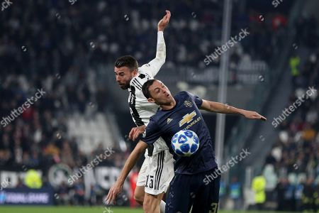 Nemanja Matic of Manchester United and Andrea Barzagli of Juventus