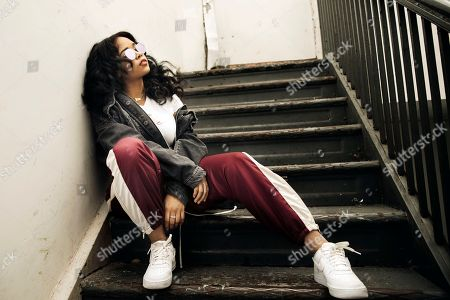 """R&B singer Gabi Wilson, better known as H.E.R., poses for a portrait in New York. She is Apple Music's latest """"Up Next"""" artist and ranks sixth among R&B artists on the streaming platform"""