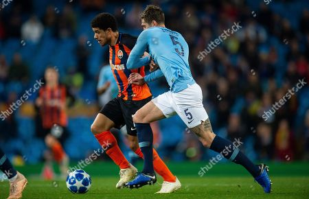 Shakhtar's Taison (L) in action with Manchester City's John Stones (R) during the UEFA Champions League Group F soccer match between Manchester City and Shakhtar Donetsk held at the Etihad Stadium in Manchester, Britain, 07 November 2018.