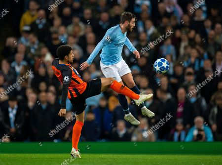 Shakhtar's Taison (L) in action with Manchester City's Bernardo Silva (R) during the UEFA Champions League Group F soccer match between Manchester City and Shakhtar Donetsk held at the Etihad Stadium in Manchester, Britain, 07 November 2018.
