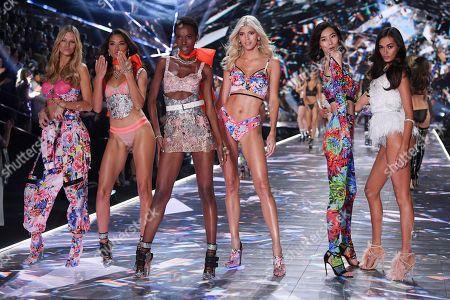 Shanina Shaik, Herieth Paul, Devon Windsor and models on the catwalk