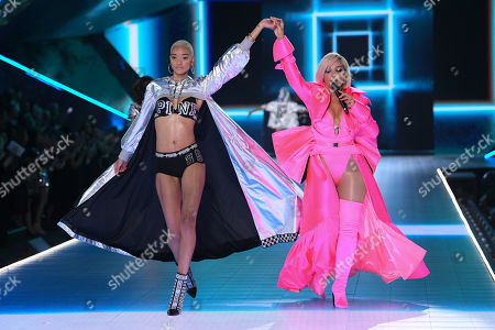 Iesha Hodges and Bebe Rexha performing on the catwalk