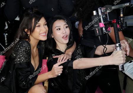 Bella Hadid and Ming Xi backstage