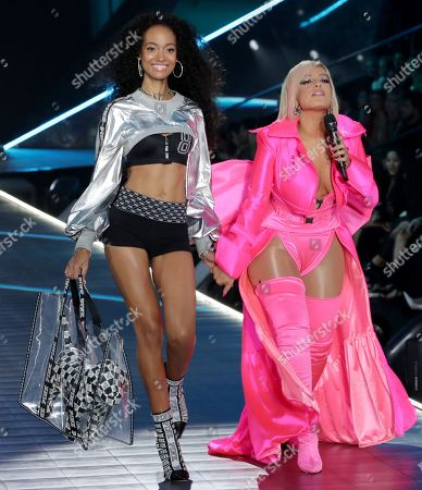 Melie Tiacoh on the catwalk with Bebe Rexha performing