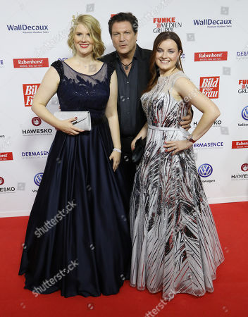 Winners Nicole John (L) and Nadja Benndorf (R) with actor Francis Fulton Smith (C) on the Red Carpet for the 'Goldene Bild der Frau' Awards ceremony in Hamburg, northern Germany, 07 November 2018. The 'Goldene Bild der Frau' is awarded to women in voluntary positions.