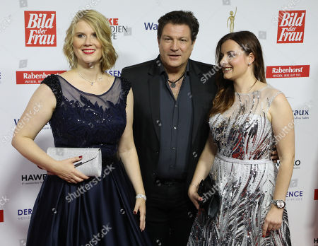 Stock Picture of Winners Nicole John (L) and Nadja Benndorf (R) with actor Francis Fulton Smith (C) on the Red Carpet for the 'Goldene Bild der Frau' Awards ceremony in Hamburg, northern Germany, 07 November 2018. The 'Goldene Bild der Frau' is awarded to women in voluntary positions.