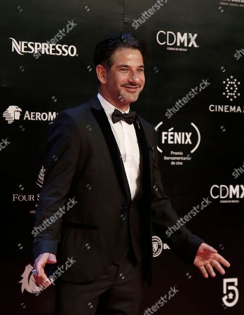 Mexican actor Miguel Rodarte poses for photographers on his red carpet walk during the Fenix Iberoamerican Film Awards, at the Esperanza Iris Theater in Mexico City