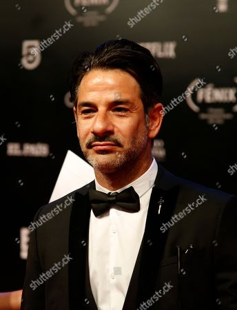 Mexican actor Miguel Rodarte poses for photographers on his red carpet walk as he arrives during the Fenix Iberoamerican Film Awards at Esperanza Iris Theater in Mexico City