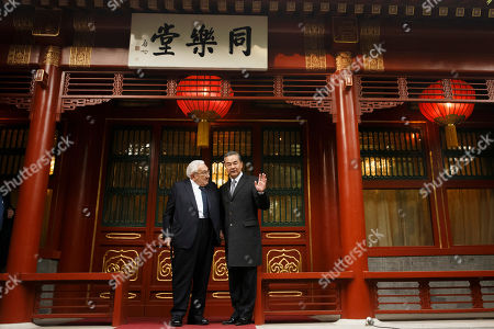 Chinese Foreign Minister Wang Yi (R) waves while posing for a photograph with former US Secretary of State Henry Kissinger (L) at the Diaoyutai State Guesthouse in Beijing, China, 08 November 2018.