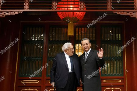 Chinese Foreign Minister Wang Yi (R) poses for a photograph with former US Secretary of State Henry Kissinger (L) at the Diaoyutai State Guesthouse in Beijing, China, 08 November 2018.