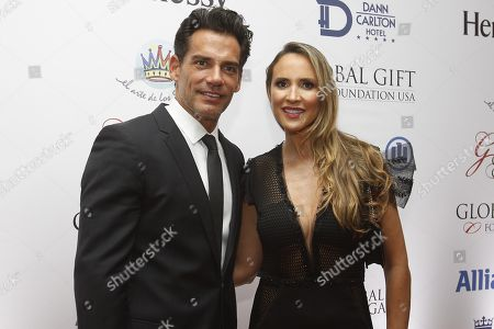 Chilean actor Cristian de la Fuente (L) and his wife Angelica Castro arrive for 'The Global Gift Gala' charity event in Medellin, Colombia, 07 November 2018. Maluma gathered several celebrities in Medellin to raise funds for his foundation 'The art of dreams'.
