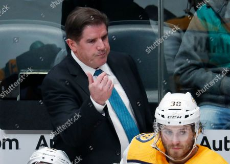 Peter Laviolette, peter laviolette. Nashville Predators coach Peter Laviolette, back, calls over officials to issue a coach's challenge on a goal scored by Colorado Avalanche center Colin Wilson during the third period of an NHL hockey game, in Denver. The goal was denied after review. Nashville won 4-1