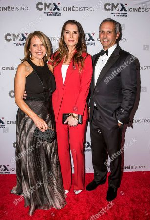 Katie Couric, Brooke Shields, John Molner. Actress Brooke Shields, center, poses with Katie Couric and husband, John Molner, at the CMX CineBistro opening night special screening event hosted by The Cinema Society, in New York